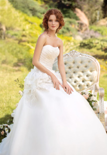 Style #1418, strapless organza ball gown wedding dress with beaded floral details, available in cream