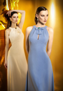 Style #0901, fit and flare long sleeves high neck with a small slit on the chest and a bow with a gem on the center, available in cream, black, white, powder and blue