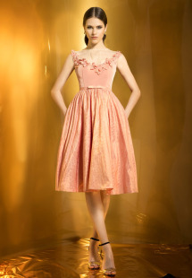 Style #0937, fit and flare illusion neckline with pleated mesh and flower embroidery around the scoop neckline, jacquard skirt with a bow, available in orange with gold and gray blue with gold