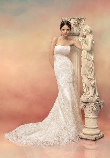 Style #1529L, fit and flare lace wedding gown, available in light ivory