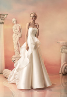 Style #1531, a-line mikado wedding dress with organza peplum, available in white and ivory