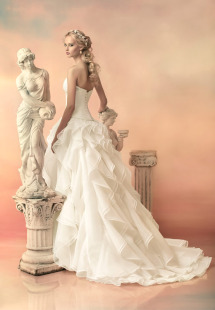 Style #1534L, ball gown wedding dress with ruffled organza skirt, available in white and ivory
