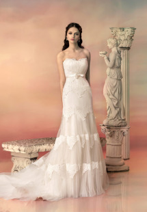 Style #1536L, fit and flare wedding dress with tired lace appliques, available in light ivory