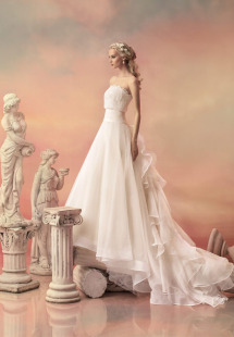 Style #1540L, a-line wedding gown with ruffled organza train, available in white and ivory