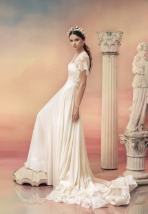 Style #1549L, a-line chiffon wedding dress with long train and separate lace cap sleeve bolero, available in white and ivory