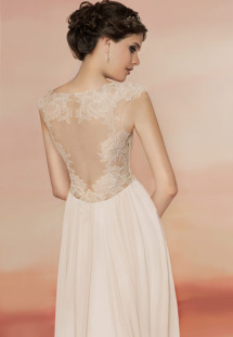 Style #1560, a-line wedding gown with lace bodice and illusion back, available in light ivory