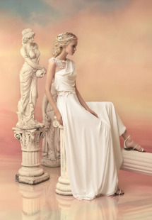 Style #1532, draped sheath wedding dress with illusion panels and floral appliques, available in white and ivory