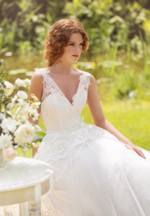 Style #1408, lace ball gown wedding dress with peplum, available in ivory
