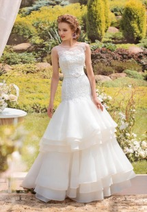 Style #1413, beaded lace and organza mermaid wedding gown, available in ivory
