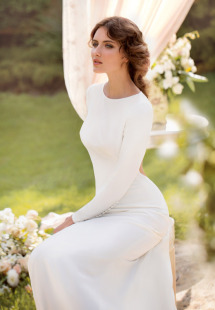 Style #1415, long sleeve fitted wedding gown with open back, available in ivory