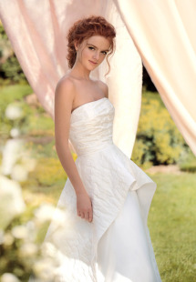 Style #1425, jacquard a-line wedding gown with peplum skirt, available in ivory