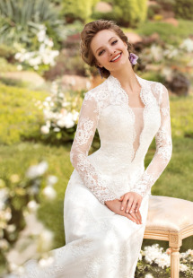 Style #1444, long sleeve lace wedding gown with plunging neckline, available in white and ivory