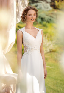 Style #1453, chiffon sheath wedding gown with sheer sides, available in white and ivory