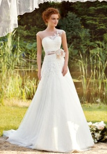 Style #1455, lace a-line wedding dress with illusion neckline, available in ivory