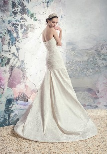 Style #1608L Premium, strapless fit and flare jacquard wedding gown, available in light ivory