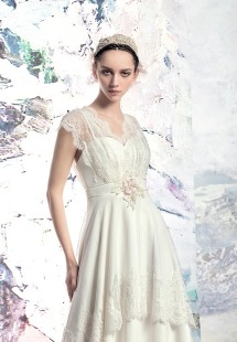 Style #1613L, vintage-inspired sheath wedding dress with lace details, available in white and ivory