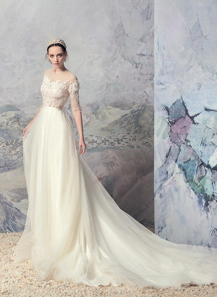 Style #1635L, A-line wedding gown with lace illusion neckline and 3/4 length sleeves, available in ivory