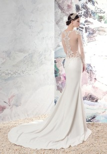 Style #1670L, fitted wedding gown with plunging neckline, illusion long sleeves and cutouts on sides, low back, and lace appliques, available in ivory