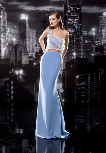Style #115, one shoulder fitted floor length dress with white string embellishments hanging off the top and revealing slit between the chest and waist, available in black, blue, cream, pink-ivory, green, light blue, red and white