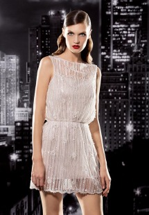 Style #131, cocktail boat neckline dress with overlay mesh decorated with fringe embellishments, available in milk and cream