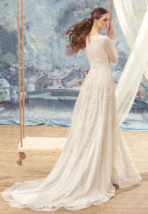 Style #1705L, long sleeve A-line wedding gown with lace appliques and embroidery, available in ivory
