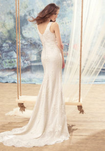 Style #1708L, beaded lace sheath wedding dress with bow detail on the plunging neckline top, available in ivory