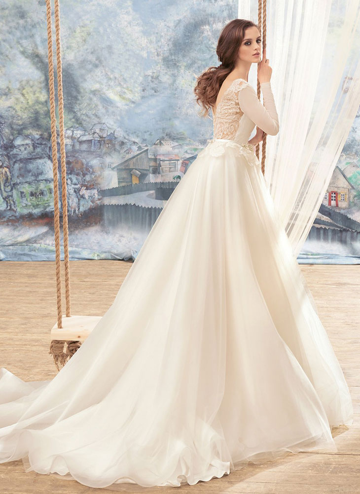 Style #1709L, tulle ball gown with lace open back, long sleeves and floral 3-D embroidery at the waist, available in ivory