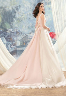Style #1713L, organza ball gown with hand beaded belt and floral décor at the back, available in ivory, ivory-pink (photo)