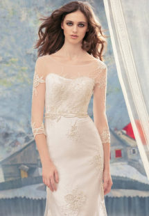 Style #1715, beaded lace sheath wedding dress with illusion 3/4 length sleeves and embroidery around the waist, available in ivory