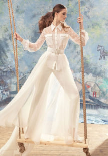 Style #1725, lace button up long sleeve blouse with fitted trousers and organza skirt, available in cream