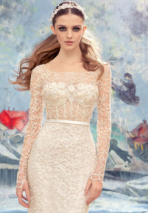 Style #1727L, fitted lace wedding gown with sheer lace bodice with long sleeves, available in ivory