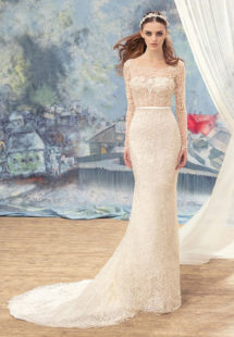 Style #1727L, beaded lace fit and flare wedding gown with sheer bodice and long sleeves, available in ivory