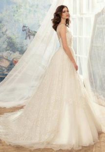 Style #1729L, tulle ball gown wedding dress with illusion neckline and lace appliques, available in cream