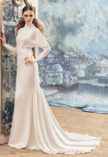 Style #1733La, open back sheath wedding dress with crystals on the high neckline, long sleeves and bow back belt, available in ivory
