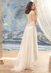 Style #1738L, illusion back A-line wedding dress with lace bodice details and pleated tulle skirt, available in ivory