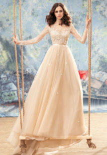 Style #1742L, tulle A-line wedding dress with sheer lace bodice, long sleeves and 3-D flower embroidery, available in white, white-ivory, ivory, nude (photo), ivory (with nude bodice)