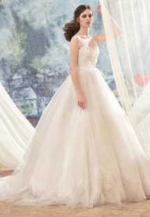 Style #1743L, tulle ball gown wedding dress with illusion lace bodice and hem details, available in ivory