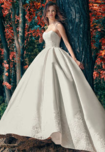 Style #1747L, strapless Mikado ball gown wedding dress with lace details and side pockets, available in white, ivory
