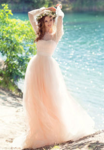 Style #1749L, bohemian tulle A-line wedding gown with off the shoulder lace sleeves and 3-D flower decor, available in ivory, peach (photo)