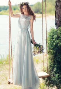 Style #1750L, A-line tulle wedding gown with loose beaded lace bodice, available in sky blue