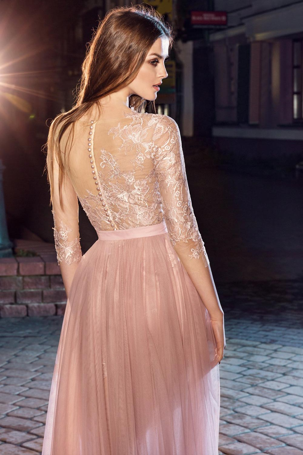 Style #207, short fitted lace dress with illusion 3/4 sleeves and detachable skirt with a rose accent, available in pink-ivory, ivory, black, cool blue
