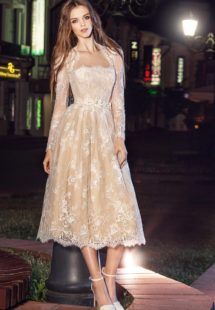 Style #213, 3/4 length lace dress with long sleeves and a straight neckline, flower embroidery on the waist that flares out, available in milk, milk on nude lining, cool blue, orange, black and pink-ivory