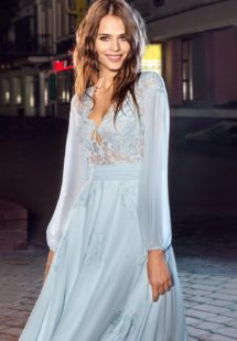 Style #215, floor length flowy gown with loose long sleeves and lace detail on top and scattered on the skirt, available in light mint