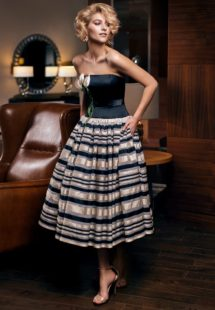 Style #302, strapless tea length cocktail dress with 3-D flower decor on the corset, and horizontal tri-colored striped skirt, available in black