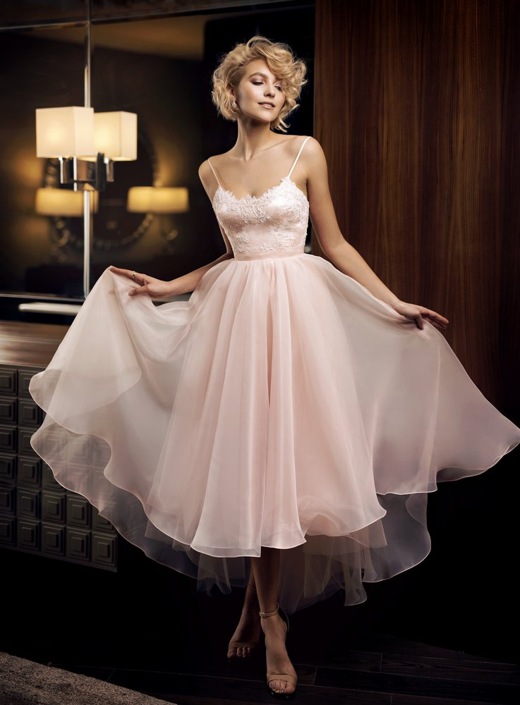 Style #308, tea length dress features fitted lace bodice, spaghetti straps and flowy skirt, available in ivory and salmon