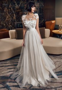 Style #311c, a-line maxi dress with illusion neckline and 3-D floral decor, available in ivory, gray-blue and ivory-pink