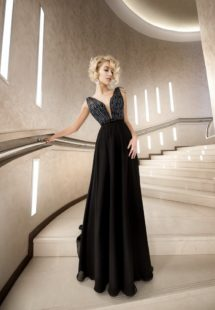 Style #316, embellished top evening gown with deep plunging neckline and accentuated natural waistline, available in black and ivory