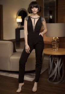 Style #321, cap sleeve pantsuit with the deep plunging neckline and embellishments on the top, available in black, ivory and powder