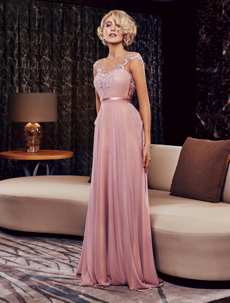 Style #322, floor length evening gown features cap sleeve, illusion neckline, and back, lace embroidery on the top, available in powder and ivory