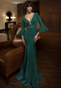 Style #328, fit and flare evening gown designed with cross straps on the v-neck, 3/4 length sleeve, and embroidered belt, available in ivory, black, red, cornflower blue, blue, powder and green